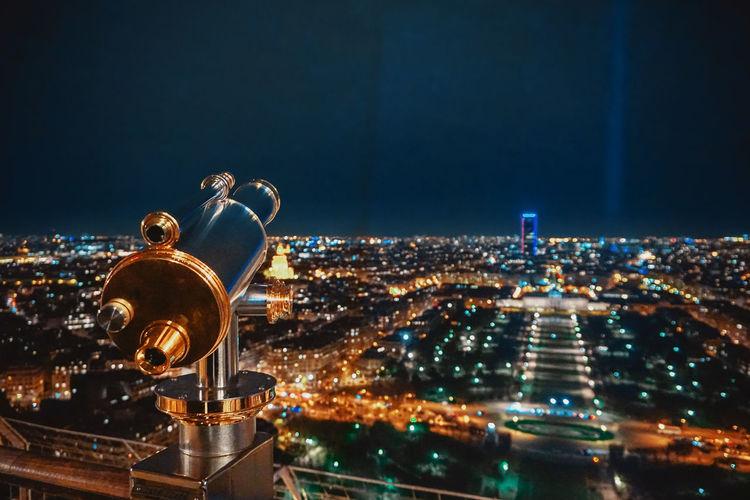 Illuminated paris cityscape against sky at night