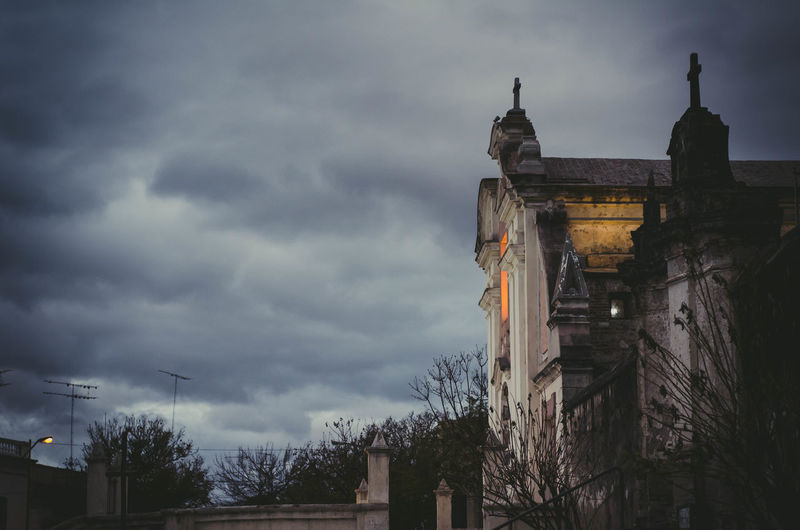 Low angle view of historic building against cloudy sky