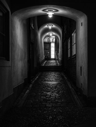 Architecture Direction The Way Forward Building Built Structure Illuminated Arch Lighting Equipment No People Door Empty Arcade Entrance Indoors  Night Corridor Diminishing Perspective Footpath Long Ceiling Alley Black And White