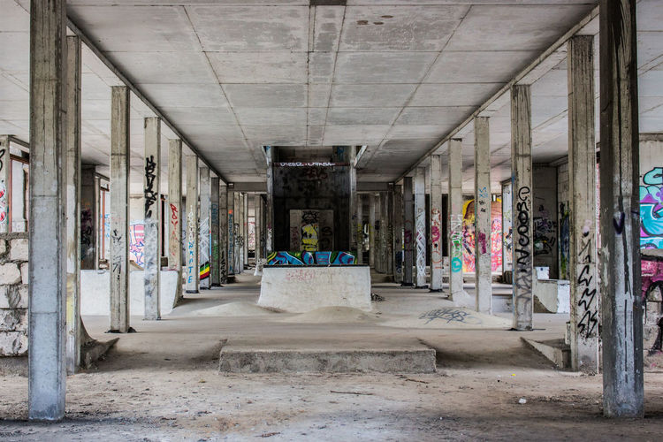 Abandoned Architecture Day Distroyed Emptiness Empty Graffiti Lost Places No People Outdoors Retail  Perspective Photography Perspective Perspective View Columns Columns And Pillars Pylons Backbone Concrete Concrete Pillars Concrete Wall Concrete Floor Skatepark The Architect - 2017 EyeEm Awards Adventures In The City