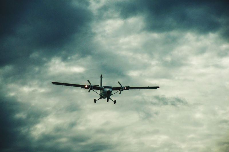 Charter Plane Storm Clouds Storm Clouds And Sky City Airplane Flying Technology Aerospace Industry Air Vehicle Mid-air Speed Journey Propeller Airplane Propeller Commercial Airplane Landing - Touching Down Private Airplane