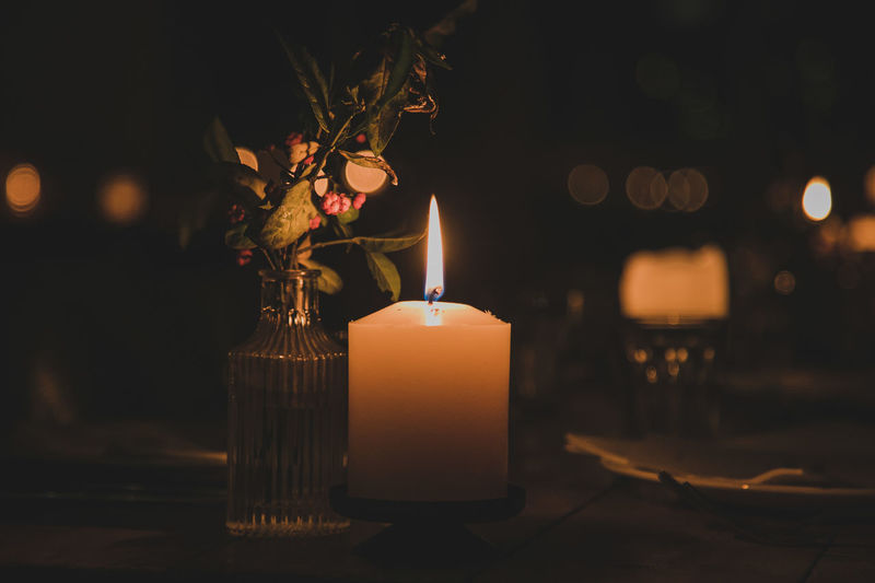 Candle Flame Illuminated Fire Burning Fire - Natural Phenomenon Heat - Temperature No People Nature Focus On Foreground Glowing Close-up Night Selective Focus Lighting Equipment Table Tree Decoration Orange Color Holiday Dark Luminosity Tea Light