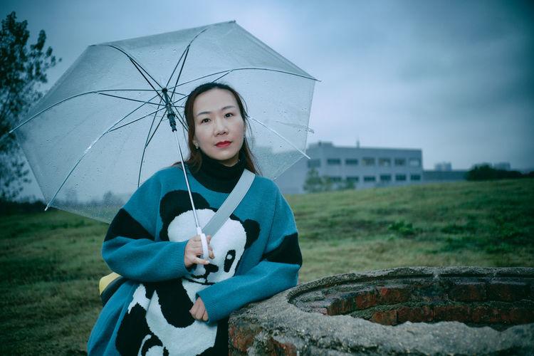 Portrait of mature woman holding umbrella