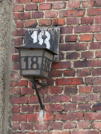 Number 18 Lamp at Aushwitz Birkenau in Poland. Brick Wall Wall - Building Feature Architecture Brick Built Structure Close-up Sad History Moment In Time