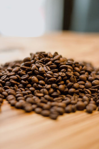 Food And Drink Food Coffee - Drink Coffee Brown Roasted Coffee Bean Freshness Indoors  Still Life Large Group Of Objects No People Close-up Selective Focus Abundance Roasted Seed Table Focus On Foreground Studio Shot Raw Food Caffeine Crockery