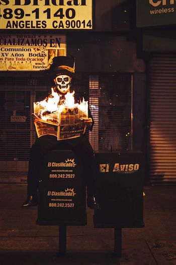 Up in flames Text Communication Illuminated Night Representation Western Script Arts Culture And Entertainment Halloween Streetwise Photography