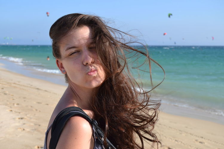 Adult Beach Beach Holiday Beauty Carefree Day Enjoyment Fun Horizon Over Water Horizontal Kiss Leisure Activity Long Hair One Person One Woman Only One Young Woman Only Only Women People Person Relaxation Sand Sea Sky Travel Destinations Vacations