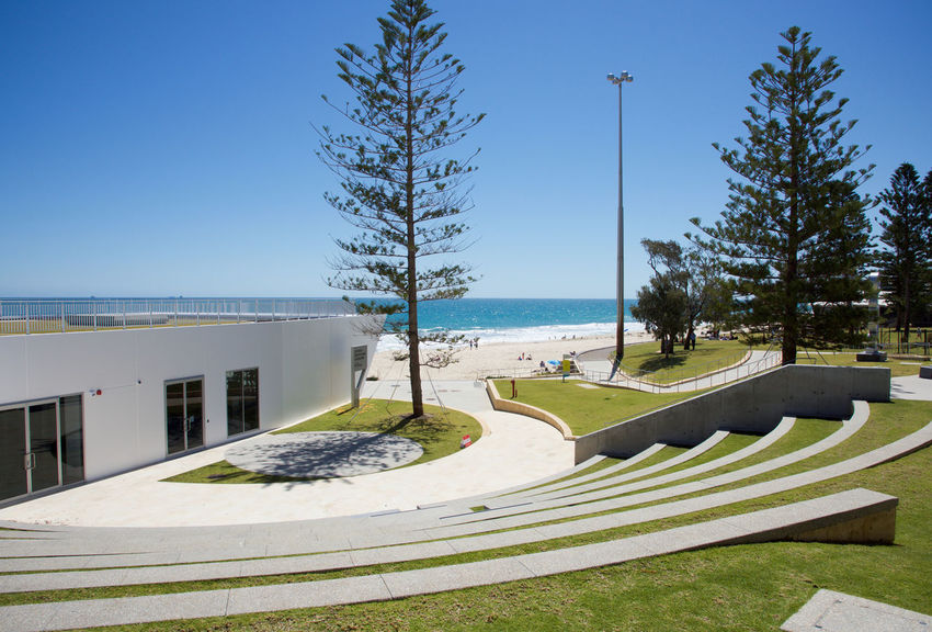 Foreshore of City Beach with grassed seating and modern architecture and an Indian Ocean view in Western Australia Architecture Beach Building City Beach Clear Sky Coastline Foreshore Horizon Over Water Indian Ocean Nature Norfolk Pines Ocean View Outdoors Resting Sand Scenic Scenics Sea Seascape Sky Tourism Travel Destinations Tree Water Western Australia