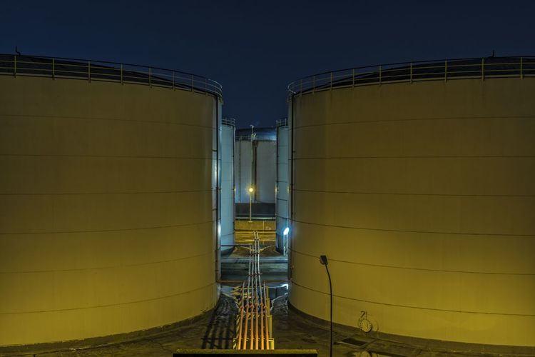Oil- and Chemical tanks Close Up Engineering Geometry Industry Modern Nightphotography No People Pipe - Tube Repetition Side By Side Symmetry Tanks