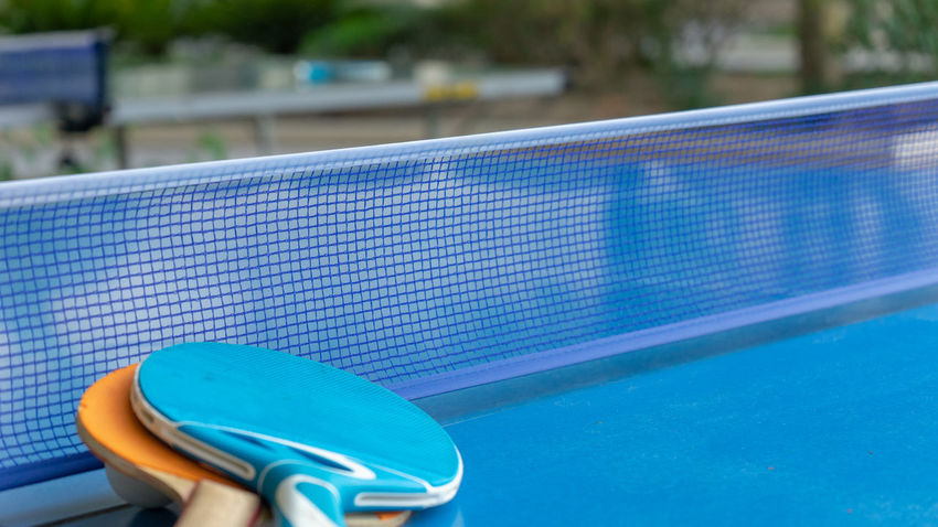 Absence Ball Blue Close-up Day Focus On Foreground High Angle View Nature No People Outdoors Pool Poolside Sport Still Life Summer Sunlight Table Tennis Water