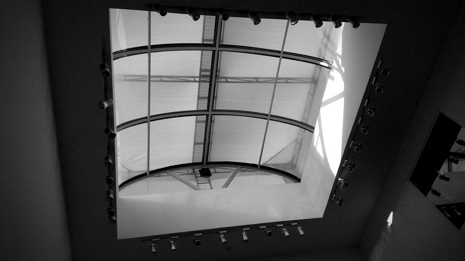 Skylight and spotlights Skylight Window Spotlights Monochrome Blackandwhite Light And Shadow Contrast Metal Beams Metal Framed Windows Mirror Reflection Ceiling Lights Ceiling