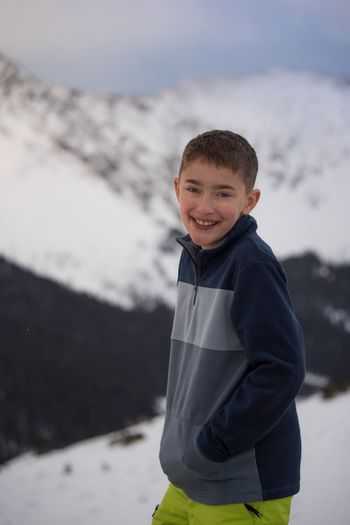 Let's go to the mountains EyeEm Selects Childhood Child Looking At Camera One Person Males  Men Smiling Portrait Boys Standing Happiness Winter Waist Up Snow Casual Clothing Focus On Foreground Cold Temperature Three Quarter Length Innocence Outdoors