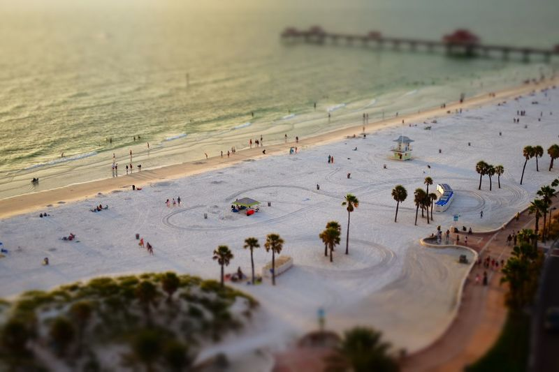 High angle view of people at beach during sunset
