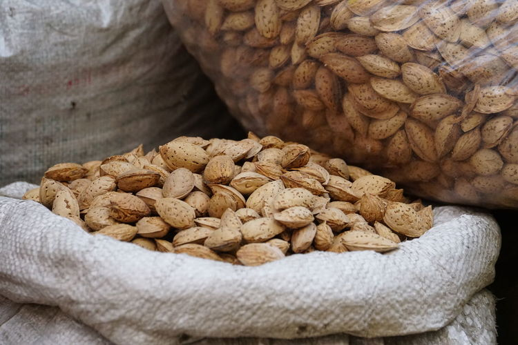 Close-Up Of Almonds In Sack For Sale