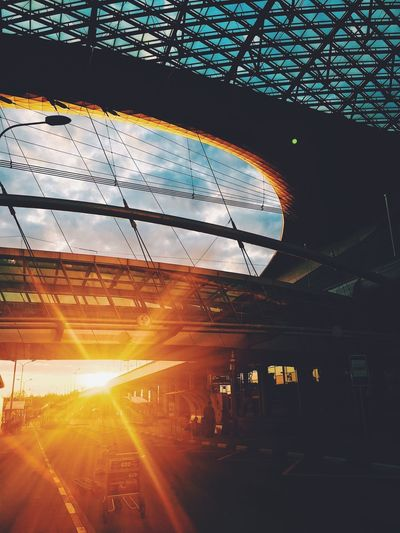 Lens Flare Sunset Transportation Indoors  Sunlight Built Structure Sky Architecture No People Day City City Street EyeEmNewHere Travel Destinations Cityscape Sunset And Clouds  Beauty In Nature EyeEm Nature Lover EyeEmNewHere EyeEmNewHere
