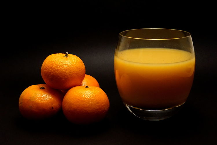 Fresh orange juice Black Background Citrus Fruit Drink Drinking Glass Food Food And Drink Fresh Fresh Orange Juice Freshness Fruit Fruit Juice Glass Healthy Eating Indoors  No People Orange Orange - Fruit Orange Color Orange Juice  Refreshment Still Life Studio Shot Wellbeing EyeEmNewHere