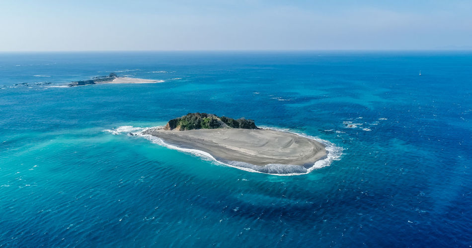Small islands in the tranquily ocean. South side of Shima peninsula, Mie prefecture Japan. View from drone. Sea Water Horizon Horizon Over Water Beauty In Nature Sky Blue Scenics - Nature Nature Day No People Land Aerial View Tranquil Scene Seascape Outdoors Idyllic Tranquility High Angle View Copy Space Dronephotography Droneshot Bird Eyes View Bird Eye Aerial View Flying Freedom Islands Pacific Ocean Iseefaces Shimane Japan Mie Prefecture Ocean Beauty In Nature Environment Trip Photo Travel Photography Jurney Eco Turism Blue Sky