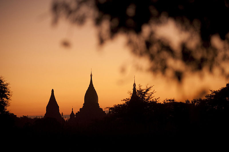 Silhouette of pagoda against sky during sunset