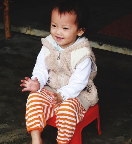 Asia. Sweet Children Child Smiling Seated Child Sitting Child Adorable Child Asian Children Asian Child EyeEm Selects Real People Childhood Child One Person Cute Front View Innocence Smiling