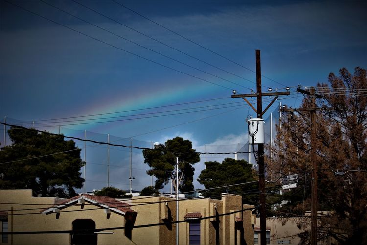 Beauty In Nature Cable Cloud - Sky Connection Day Electricity  Electricity Pylon Low Angle View Nature No People Outdoors Power Line  Power Supply Rainbow Sky Technology Telephone Line Tree