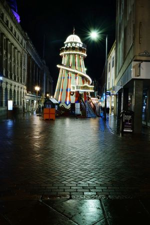 Helter-skelter at the Nottingham Christmas Market Nottingham Market Square Nottingham Market Square Night Illuminated Arts Culture And Entertainment Architecture Travel Destinations Ferris Wheel Water Outdoors