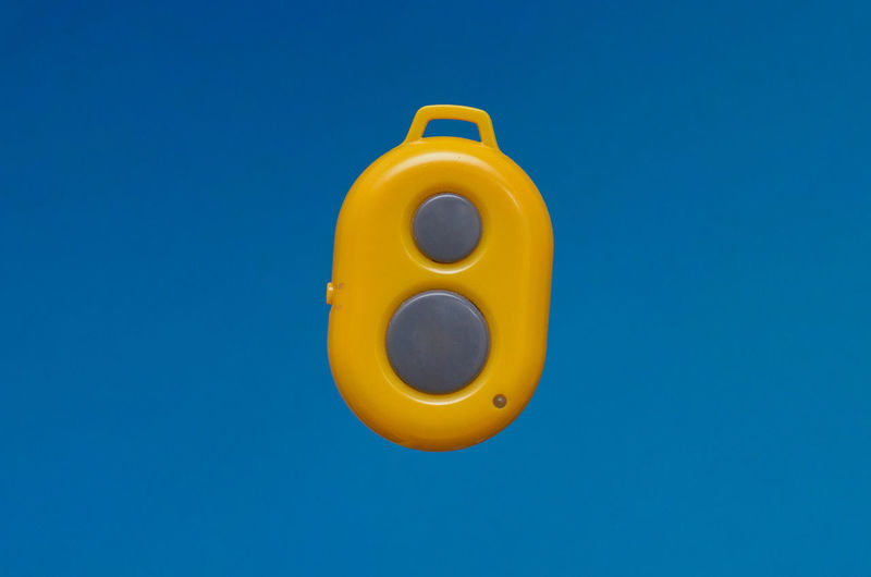 Close-up of yellow object against blue background