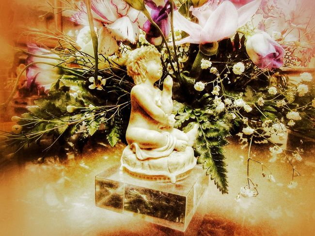 Child figure among the flowers Alabaster Ambiance Colorful Decorative Dreamlike Atmosphere Déco Figure Floweers Flower Arrangement Focus On Foreground Focus_graphy Indoor Photography Infant Meditation Garden Tranquility Vintage Decor ınnocence Pastel Colors Artistic Photography