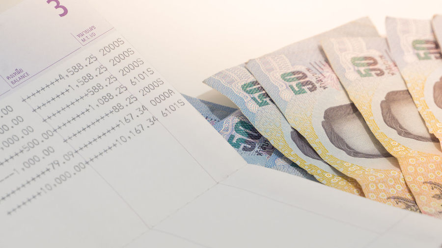 thai bank note Business Close-up Communication Currency Economy Finance High Angle View Indoors  Investment No People Number Paper Paper Currency Savings Still Life Studio Shot Table Text Wealth Western Script