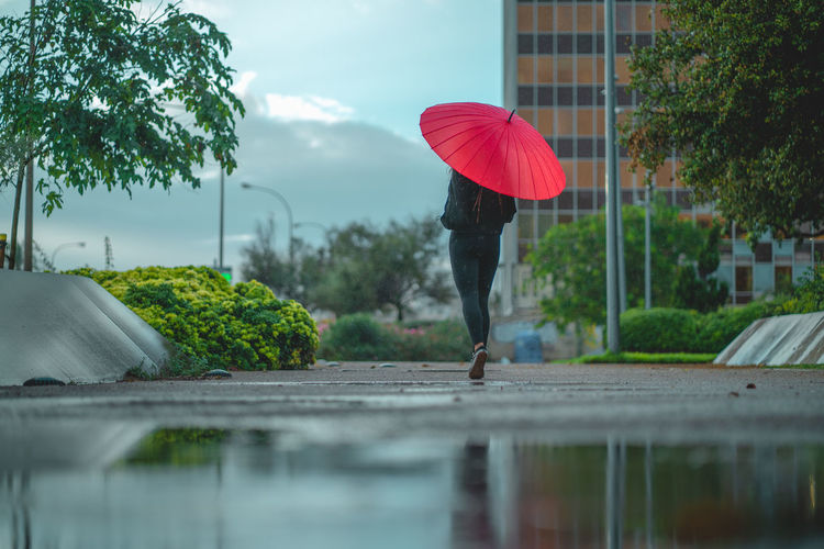 Woman standing on wet rainy day