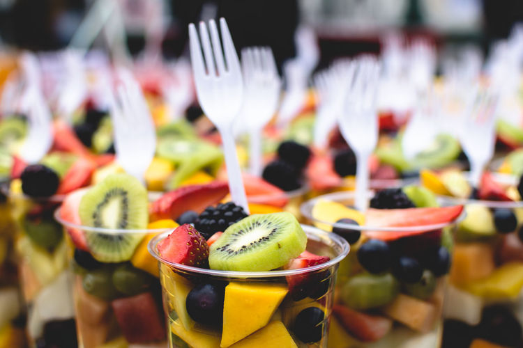 Close-up of fruit salad in disposable cups for sale at market