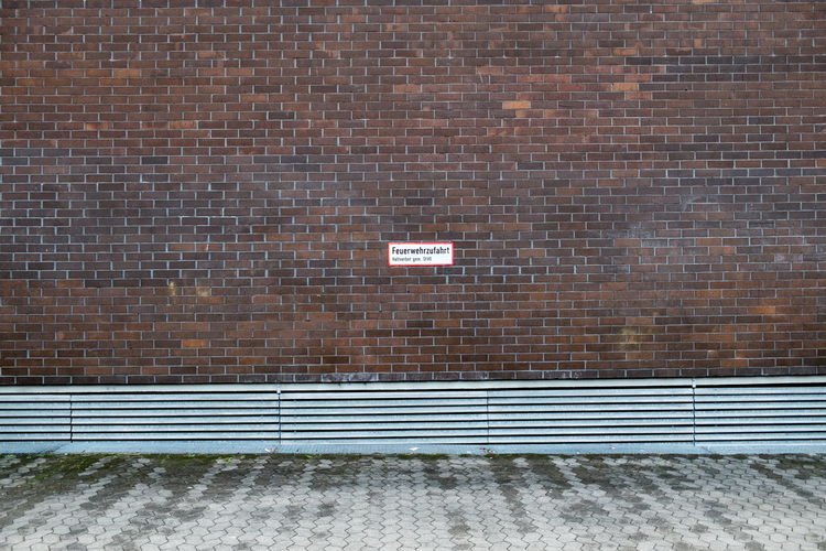 Street Against Wall With Text