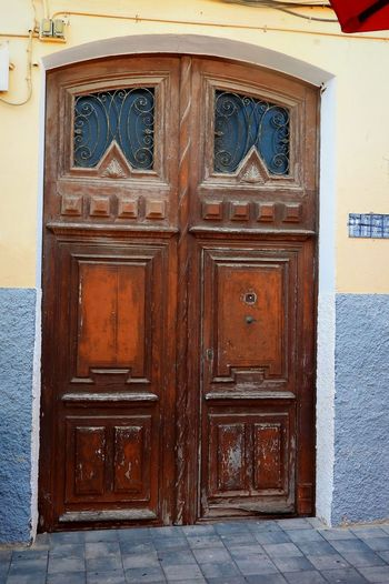 Here Stands Another Door ~ The Week On EyeEm Door Closed Entrance Safety Outdoors Wood - Material Security Day No People Built Structure Doorway Architecture Building Exterior Protection Full Frame Façade Close-up SPAIN Villajoyosa Blue Walls Wood Doors Closed Up Metalwork Arched Doorway