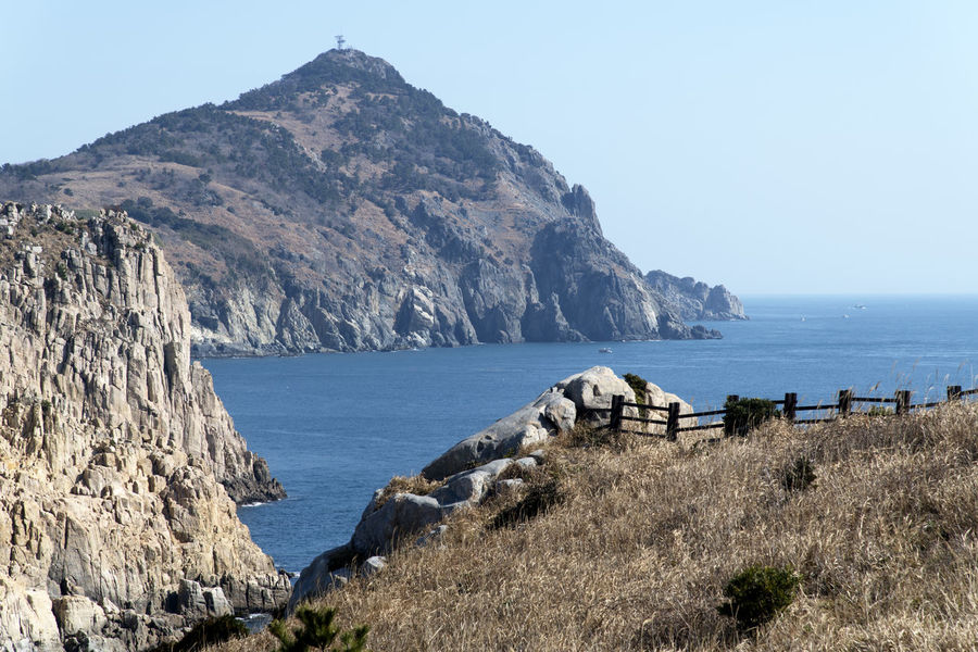 seaside view of Deungdaeseom Island (lighthouse island) by Somaemuldo in the sea of Tongyeong, Gyeongnam, South Korea. Deungdaeseom Island View  Nature's Beauty Nikon D850 Tongyeong Beauty Of Nature Bright Day D850 Outdoor Outdoors Peace In Island Peaceful Day Peaceful Island Life Sea Cliff Seaside Seaside Cliff Seaside View Somaemuldo View Of Island