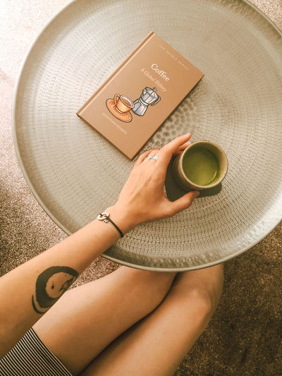 High angle view of woman holding coffee cup