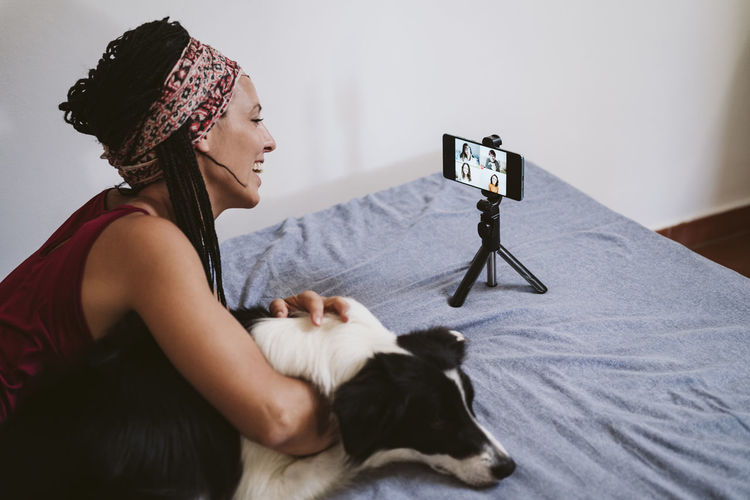 Woman with dog on bed