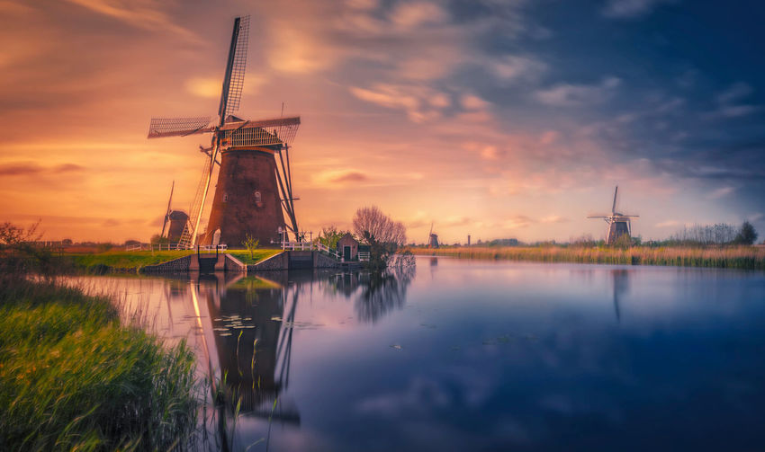 Amsterdam Kinderdijk Windmills Water Alternative Energy Fuel And Power Generation Sky Wind Turbine Renewable Energy Environmental Conservation Wind Power Turbine Environment Traditional Windmill Cloud - Sky Sunset Reflection Nature Beauty In Nature Built Structure Lake No People Outdoors Remo SCarfo EyeEm Best Shots