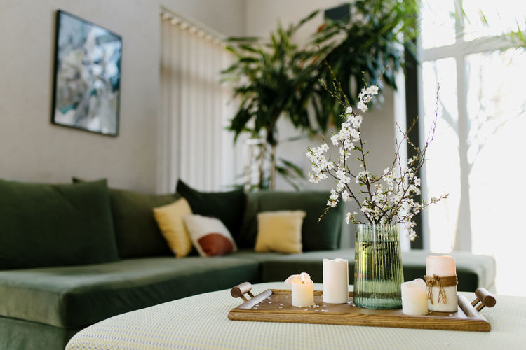 Home interior. relaxing candles. apple tree color has flown. blurred background. high quality photo