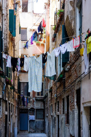 Architecture Building Exterior Built Structure Cloth Clothesline Clothing Coathanger Day Drying Hanging Home Laundry Multi Colored No People Outdoors Residential Building Textile Window
