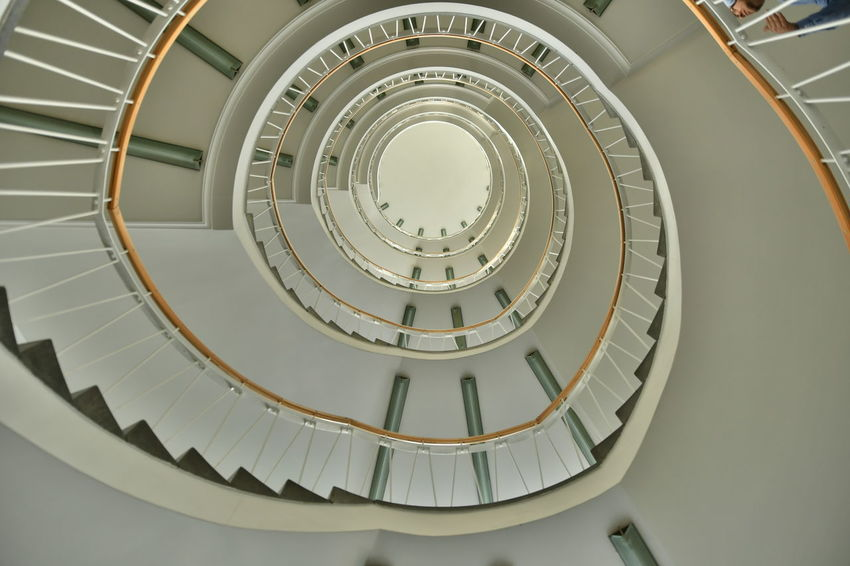 Architecture Architekturfotografie BCS Innenansicht München Schwindelig Spiral Staircase Stairs Treppenhaus Architecture Built Structure Day Indoor Architecture Indoors  Low Angle View No People Railing Spiral Spirals Staircase Staircase Perspective Steps Steps And Staircases Treppe Wendeltreppe The Architect - 2018 EyeEm Awards