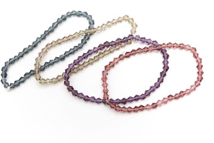 gray, opal, purple and pink swarovski crystals bracelets on white background Beads Bracelet Bracelets Close-up Crystals Jewellery Jewelry No People Swarovski White Background