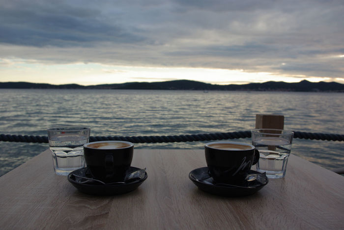 Coffee Cup Drink No People Outdoors Sea Sunset Table Tranquility Two Coffees Water