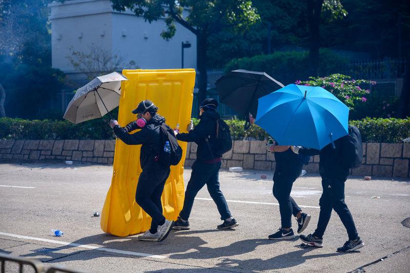 People with umbrella on wet street