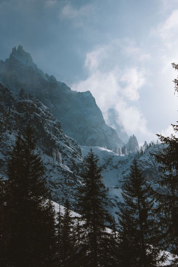 Taken in the Dolomites, Italy. Beauty In Nature Cloud - Sky Cold Temperature Coniferous Tree Environment Fog Formation Land Luxury Mountain Mountain Peak Mountain Range Nature No People Non-urban Scene Outdoors Scenics - Nature Sky Snow Tranquil Scene Tranquility Travel Destinations Tree Winter