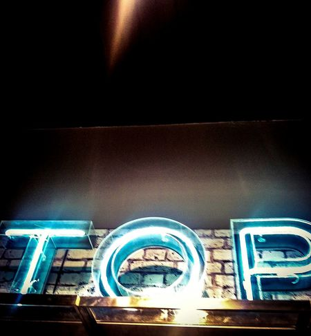 Top. Signage from a shop in town. Lighting Illuminated Shop Sign Retail Therapy Word Art Manchester