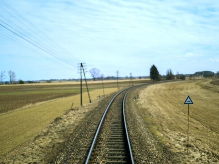 #buymyphotos #ForSale Sky Transportation Track Nature Railroad Track Rail Transportation Adventures In The City Day The Way Forward Diminishing Perspective Landscape Environment Direction Cloud - Sky No People Outdoors Sign Field vanishing point Tranquility Plant Adventures In The City