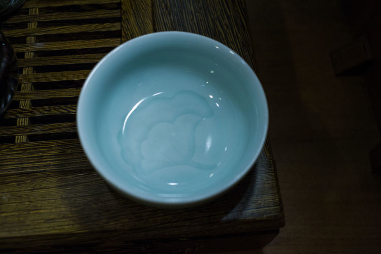 Close-up of cup on table