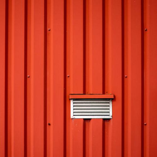 Full frame detail of red door