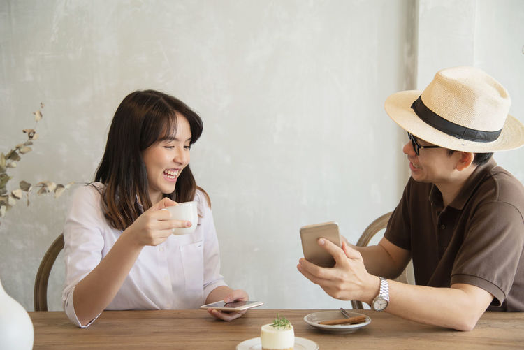 Smiling couple sitting at restaurant
