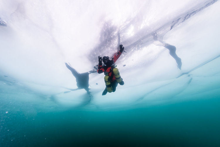 Low Angle View Of Man Underwater