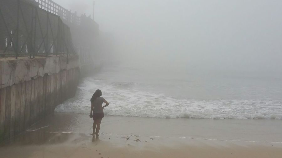 The Purist (no Edit, No Filter) Girl At Oceans Edge Ocean Beach Beautiful Nature Foggy Weather Foggy At Ocean Pier Diappearing Into Mist White Space Young Woman Relaxation Peaceful Footprints In The Sand Contemplation Thoughts Calm Waters Edge Showcase: February Seal Beach California Surf's Up